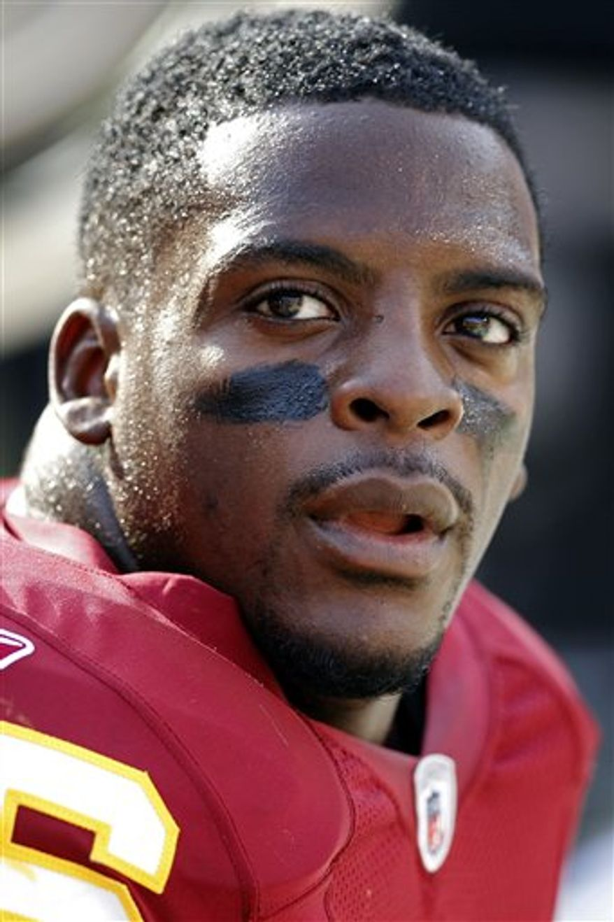 FILE - In this Sept. 2, 2010, file photo, Washington Redskins running back Clinton Portis watches from the sidelines during a preseason NFL football game against the Arizona Cardinals in Glendale, Ariz.  Portis is hoping for another chance with the Redskins. The running back said Thursday, Dec. 2, 2010, he wants to keep playing, despite back-to-back seasons that have ended early because of injuries.  (AP Photo/Ross D. Franklin, File)