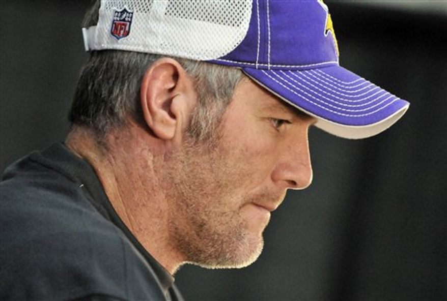 Minnesota Vikings quarterback Brett Favre ponders a question as he addresses his weekly NFL football news conference Wednesday, Nov. 10, 2010 in Eden Prairie, Minn. Favre led the Vikings to a 27-24 overtime win against the Cardinals Sunday and the team faces the Chicago Bears in Chicago on Sunday. (AP Photo/Jim Mone)