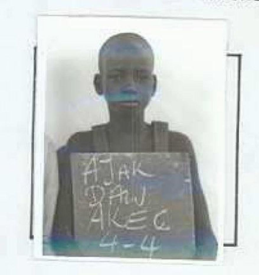 ASSOCIATED PRESS PHOTOGRAPHS This undated photo provided by the Arizona Lost Boys Center, shows the refugee identification document of Ajak Dau Akech. The documents of the group known as the Lost Boys of Sudan were thought lost for many years. The Lost Boys are now finding out more about families and history.