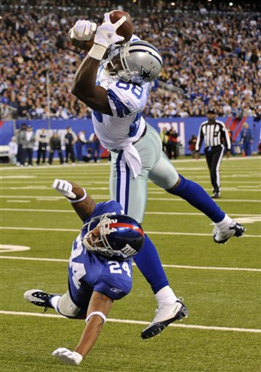 Dallas Cowboys wide receiver Dez Bryant (88) catches a pass for a touchdown as New York Giants cornerback Terrell Thomas (24) defends during the first quarter of an NFL football game at New Meadowlands Stadium on Sunday, Nov. 14, 2010, in East Rutherford, N.J. (AP Photo/Bill Kostroun)