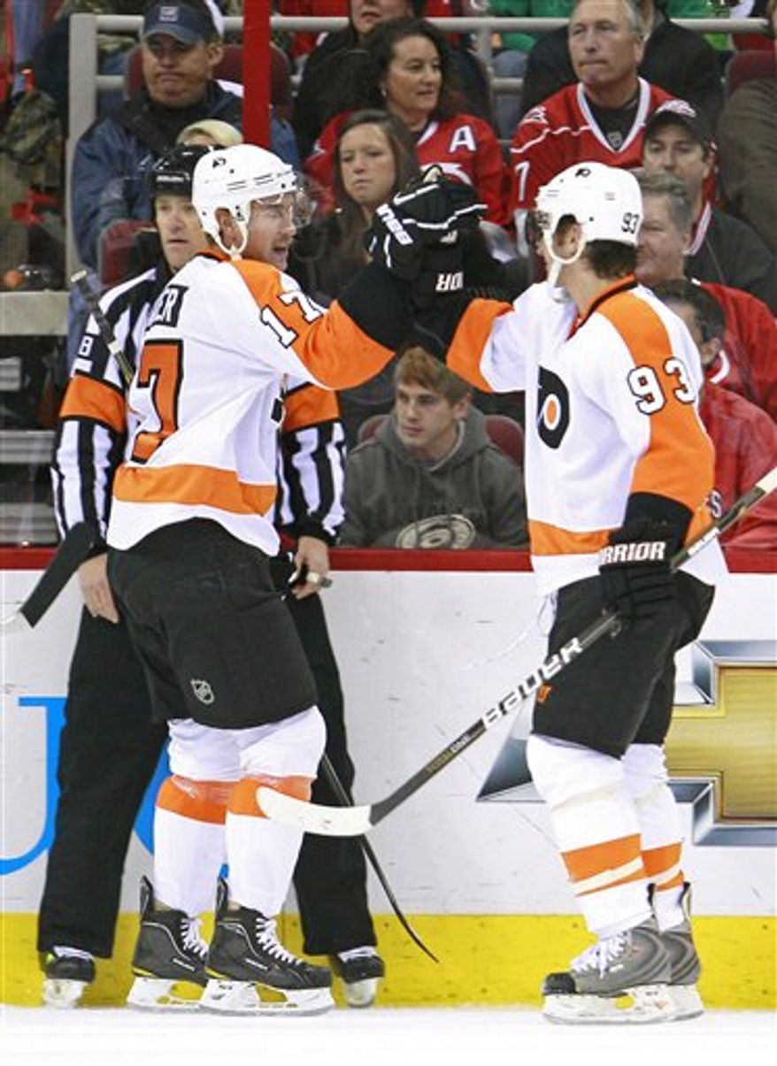 Philadelphia Flyers' Jeff Carter, left, is congratulated by Nikolay Zherdev, of Ukraine, following Carter's goal against the Carolina Hurricanes during the second period of an NHL hockey game in Raleigh, N.C., Thursday, Nov. 11, 2010. (AP Photo/Gerry Broome)