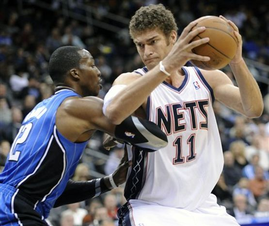 New Jersey Nets center Johan Petro (27), of France, runs into Orlando Magic guard J. J. Redick as he puts up a shot during the second quarter of an NBA basketball game Saturday, Nov. 13, 2010 in Newark, N.J. (AP Photo/Bill Kostroun)