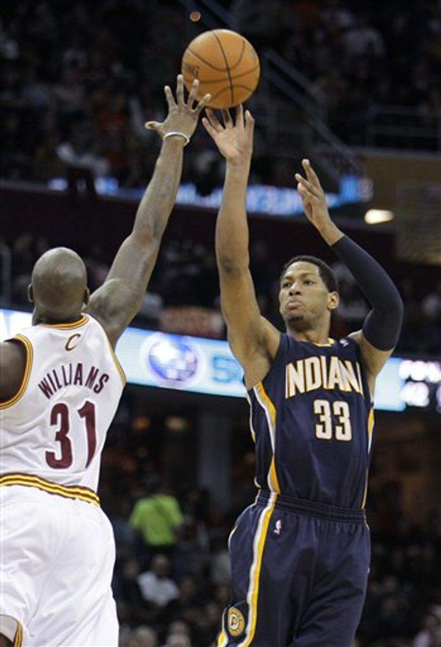 Cleveland Cavaliers' Ramon Sessions (3) fouls Indiana Pacers' Darren Collison (2) trying for a steal in the fourth quarter of an NBA basketball game Saturday, Nov. 13, 2010, in Cleveland. The Pacers won 99-85. (AP Photo/Mark Duncan)