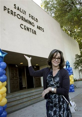 Actress Sally Field poses outside the Sally Field Performing Arts Center at Birmingham High School Friday Nov. 12, 2010 in Los Angeles. Field graduated from Birmingham H.S. in 1964 and was a cheerleader. (AP Photo/Nick Ut)