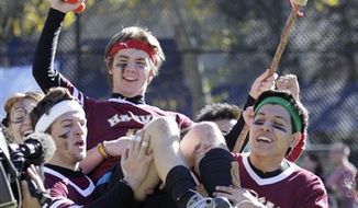 A contestant rides his broom during competition at the 4th annual Quidditch World Cup held at Dewitt Clinton Park, Saturday, Nov. 13, 2010 in New York.  (AP Photo/Mary Altaffer)