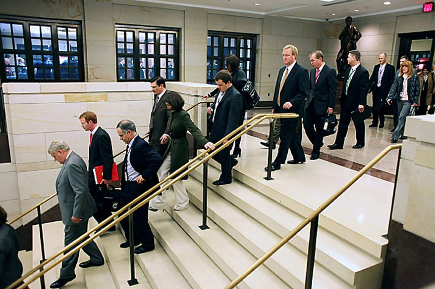 Freshmen Congressional members, and their staff,  arrive for their first day of orientation on Capitol Hill in Washington, Monday, Nov. 15, 2010. (AP Photo/Harry Hamburg)