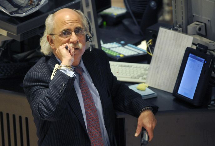 Peter Tuchman works on the floor of the New York Stock Exchange, Tuesday, Oct. 19, 2010, in New York. The Dow Jones industrial average fell below 11,000 for the first time in nearly a month Tuesday, Nov. 16, 2010, as worries mounted about inflation in Asia and as European leaders met to discuss a bailout of Ireland. (AP Photo/Henny Ray Abrams)
