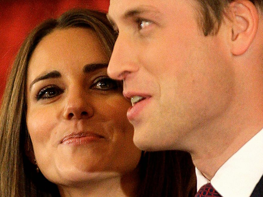 Britain's Prince William and his fiancee Kate Middleton pose for the media at St. James's Palace in London after announcing their marriage, London, Tuesday, Nov. 16, 2010. The couple are to wed in 2011.(AP Photo/Sang Tan)