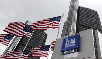 ** FILE ** The world headquarters of General Motors Co. in Detroit are pictured in 2009. (Associated Press)