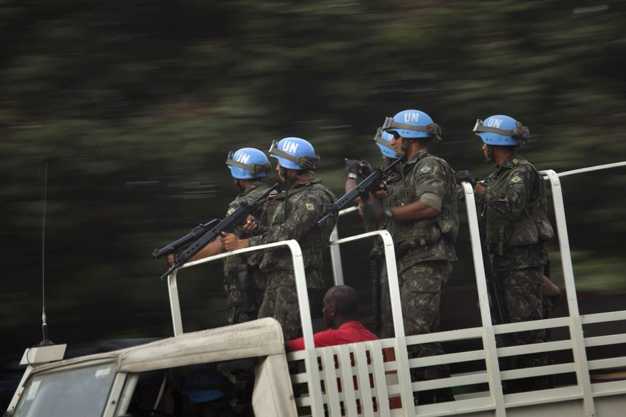 U.N. peacekeepers from Brazil patrol in Port-au-Prince, Haiti, Monday Nov. 15, 2010. Protesters who hold Nepalese U.N. peacekeepers responsible for an outbreak of cholera that has killed 1,000 in three weeks threw stones and threatened to set fire to a base in Cap-Haitien, the country's second-largest city Monday, Haitian radio and eyewitnesses reported.(AP Photo/Emilio Morenatti)