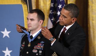 President Obama presents the Medal of Honor to Army Staff Sgt. Salvatore Giunta during a ceremony in the East Room of the White House in Washington, Tuesday, Nov. 16, 2010. Sgt. Giunta, from Hiawatha, Iowa, is the first living veteran of the wars in Iraq and Afghanistan to receive the award. (AP Photo/Charles Dharapak)