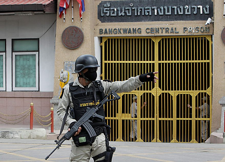 Thai prison security officer stands guard in front of Bangkwan central Prison in Nonthburi province before the extradition of suspected Russian arms smuggler Viktor Bout, on Tuesday, Nov. 16, 2010.  The Thai government extradited accused Russian arms trafficker Viktor Bout to the United States on Tuesday to face terrorism charges, rejecting heavy pressure from Moscow for him to be freed. (AP Photo/Sakchai Lalit)
