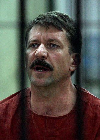 In this file photo taken on Aug. 11, 2010, alleged Russian arms dealer Viktor Bout answers a question from inside the detention room at a criminal court in Bangkok, Thailand.  The Thai government extradited accused Russian arms trafficker Viktor Bout to the United States on Tuesday, Nov. 16, 2010,  to face terrorism charges, rejecting heavy pressure from Moscow for him to be freed. (AP Photo/Apichart Weerawong, File)