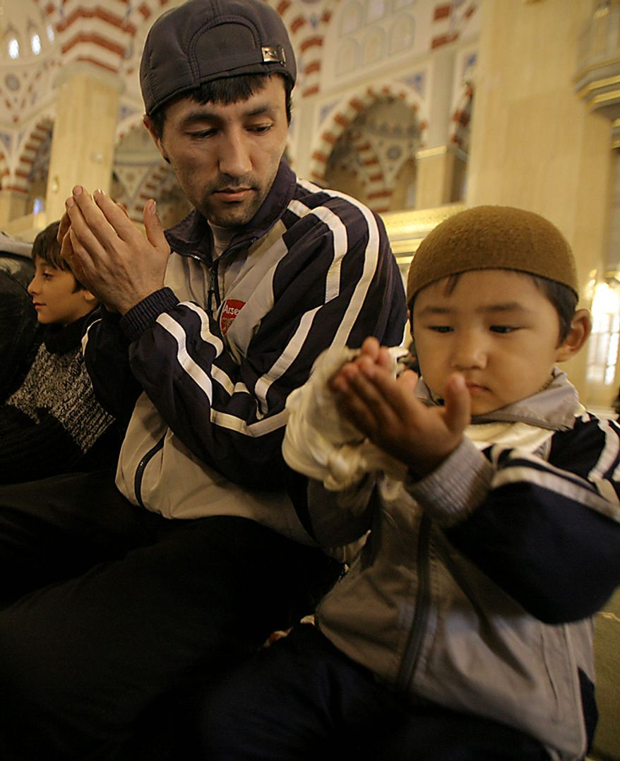 Muslims pray outside in a mosque  in Grozny, Russia, as they celebrate Eid al- Adha, which Muslims in Russia call Kurban-Bairam, on Tuesday, Nov. 16, 2010. Muslims worldwide celebrate Eid al-Adha, or the Feast of the Sacrifice, by sacrificial killing of sheep, goats, cows or camels. (AP Photo/Musa Sadulayev)