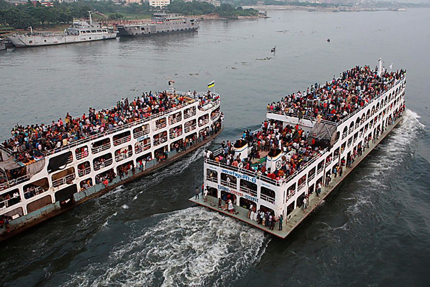 Hundreds of Bangladeshi passengers headed to the southern districts to celebrate Eid al-Adha travel in overcrowded ferries through the Buriganga river in Dhaka, Bangladesh, Tuesday, Nov.16, 2010.(AP Photo/Pavel Rahman)