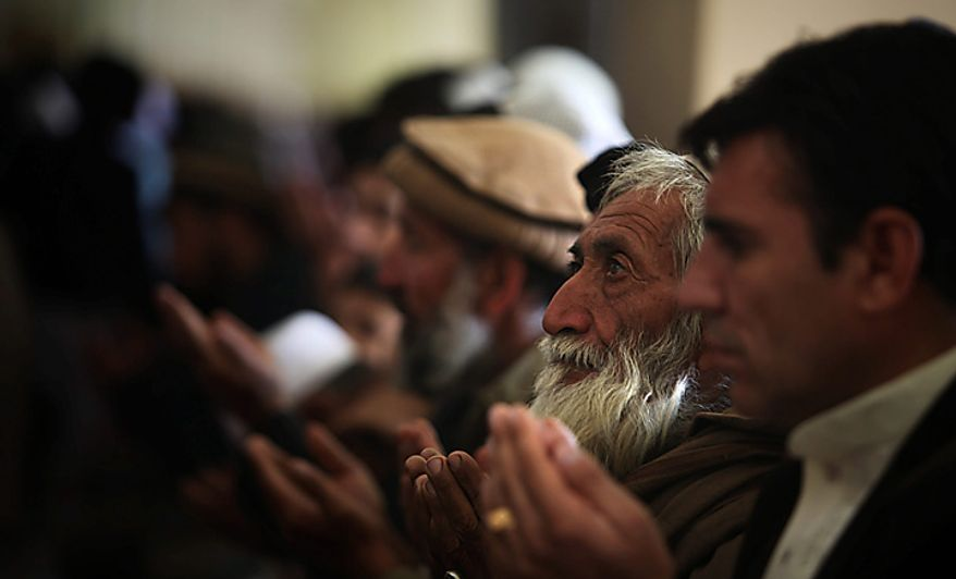 Afghan men pray inside a mosque during Eid al-Adha festival in Kabul, Afghanistan, Tuesday, Nov. 16, 2010.  Muslims worldwide celebrate Eid al-Adha, or the Feast of the Sacrifice by sacrificial killing of livestock to commemorate the religious story of Abraham. (AP Photo/Altaf Qadri)