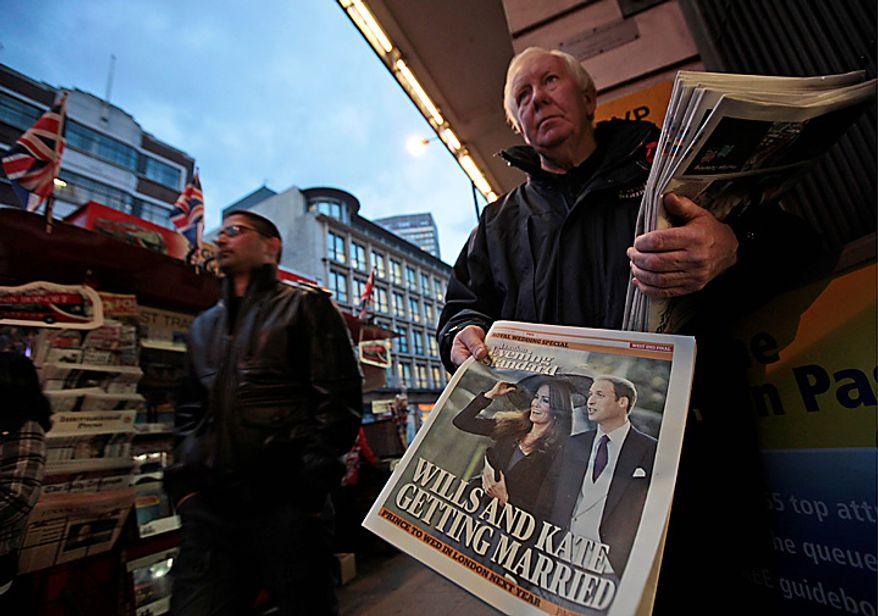 A man distributes copies of a free evening newspaper with front-page story and picture of Britain's Prince William engagement with girlfriend Kate Middleton, outside a central London's train station, Tuesday, Nov. 16, 2010. Britain's Prince William, who is second in line to the throne, and Middleton are engaged and will marry next spring or summer in London _ a royal wedding that Britons have been eagerly awaiting for years. The announcement Tuesday by royal officials ends an on-again, off-again romance that began after the two met more than eight years ago as students at the University of St. Andrews in Scotland. Prince William turned 28 in June and recently completed training a Royal Air Force search and rescue pilot.(AP Photo/Lefteris Pitarakis)