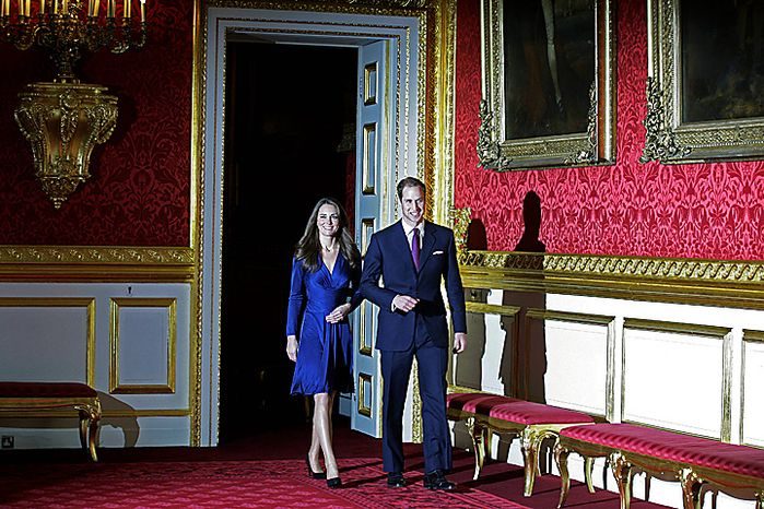 Britain's Prince William and his fiancee Kate Middleton  walk into the room for a photo-call  at St. James's Palace in London, Tuesday Nov. 16, 2010, after they announced their engagement. The couple are to wed in 2011. (AP Photo/Sang Tan)