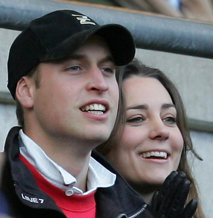 Britain's Prince William and Kate Middleton, watch the England against Italy Six Nations rugby match at Twickenham stadium in London, in this Saturday Feb. 10, 2007 file photo. According to an announcement by Clarence House in London, Tuesday Nov. 16, 2010,  the couple are to wed in 2011, Further details about the wedding day will be announced in due course.(AP Photo/David Davies, pa, file)