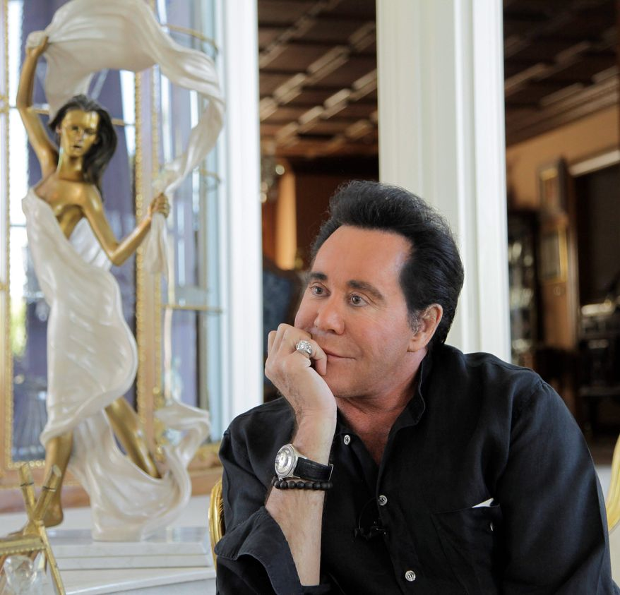 ASSOCIATED PRESS PHOTOGRAPHS Entertainer Wayne Newton, an icon of Las Vegas, wants to create a museum representing his life at his home. His neighbors, however, are not enthusiastic about the prospect of tour buses, more traffic and gift shops invading their affluent neighborhood just six miles from the Las Vegas Strip.