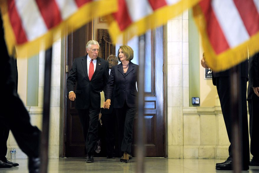 Associated Press photographs House Speaker Nancy Pelosi, California Democrat, and House Majority Leader Steny H. Hoyer, Maryland Democrat, walk to a news conference on Capitol Hill on Wednesday, after being re-elected as the leaders of the House Democrats, although they will be in the minority in the 112th Congress next year.