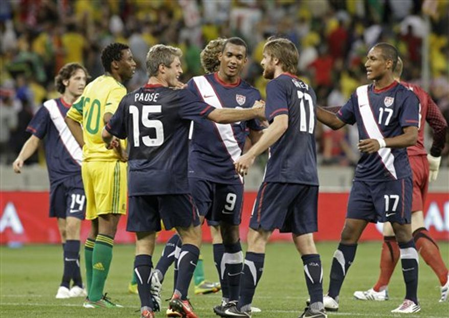 United States players, from left, Logan Pause (15), Matthew Pattison (9), Eddie Gaven (11) and Juan Agudelo (17) celebrate after they beat South Africa 1-0 in an international friendly soccer match in the Nelson Mandela Challenge at Cape Town, South Africa, Wednesday, Nov. 17, 2010. Agudelo score the USA's winner. (AP Photo/Schalk van Zuydam)