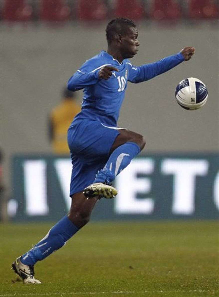Italy's Mario Balotelli is controlls the ball during their international friendly soccer match against Romania in Klagenfurt, Austria, Wednesday, Nov. 17, 2010. (AP Photo/Darko Bandic)