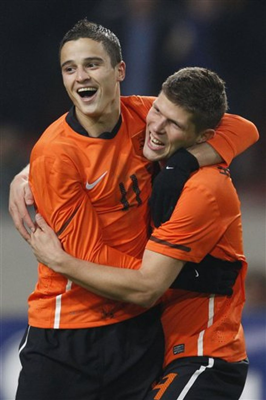 Dutch players hug Klaas Jan Huntelaar, right, of the Netherlands after he scored 1- 0 against Turkey during their international friendly soccer match at ArenA stadium in Amsterdam, Netherlands, Wednesday Nov. 17, 2010. (AP Photo/Peter Dejong)