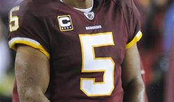 Quarterback Donovan McNabb started 13 games for the Washington Redskins in 2010, throwing for 3,377 yards, 14 touchdowns and 15 interceptions. (AP Photo/Nick Wass)