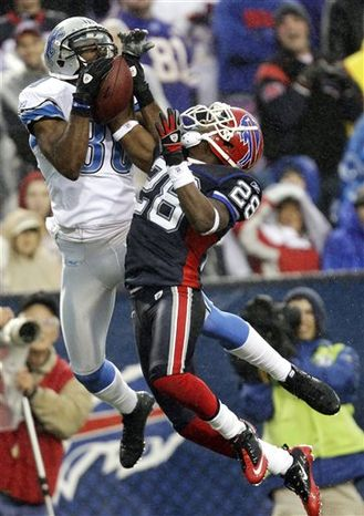 Buffalo Bills' Leodis McKelvin (28) breaks up a pass intended for Detroit Lions' Bryant Johnson (80) during the second half of an NFL football game in the rain in Orchard Park, N.Y., Sunday, Nov. 14, 2010. The Bills won 14-12. (AP Photo/David Duprey)
