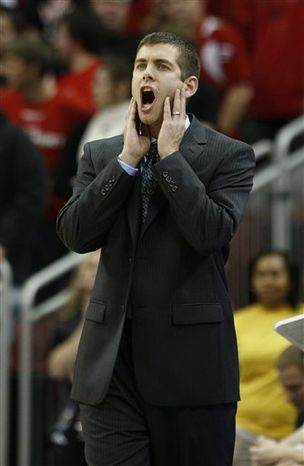 Butler coach Brad Stevens shouts to his team during the first half of their NCAA college basketball game against Louisville in Louisville, Ky., Tuesday, Nov. 16, 2010.  (AP Photo/Ed Reinke)