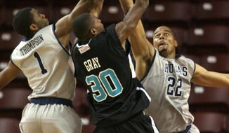 ASSOCIATED PRESS Coastal Carolina's Chad Gray (30) has his shot blocked by Georgetown's Hollis Thompson (1) and Julian Vaughn (22) during first half action during the ESPN Charleston Classic basketball tournament at the Carolina First Arena in Charleston, S.C., Thursday, Nov. 18, 2010. Georgetown won 80-61.
