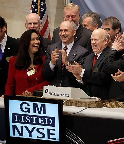 General Motors Co. CEO Dan Akerson, right, and other dignitaries celebrate after ringing the opening bell at the New York Stock Exchange in New York, Thursday, Nov. 18, 2010.  (AP Photo/Seth W