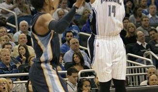 Orlando Magic point guard Jameer Nelson (14) makes a 3-point shot over Memphis Grizzlies guard Mike Conley during the second half of an NBA basketball game in Orlando, Fla., Monday, Nov. 15, 2010. Orlando won 89-72.(AP Photo/John Raoux)