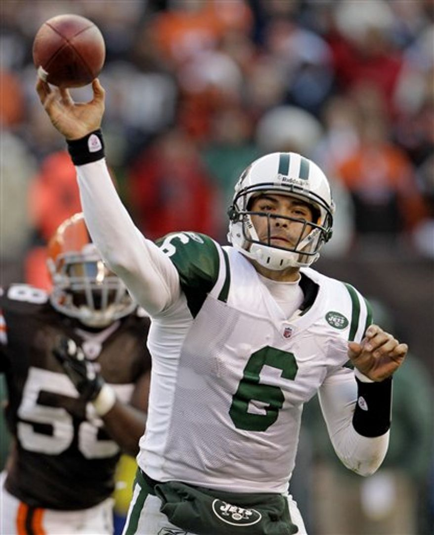 Cleveland Browns quarterback Colt McCoy (12) is sacked by New York Jets linebacker Calvin Pace (97) for a loss of one yard in the fourth quarter in an NFL football game Sunday, Nov. 14, 2010, in Cleveland. The Jets won 26-20. (AP Photo/Tony Dejak)