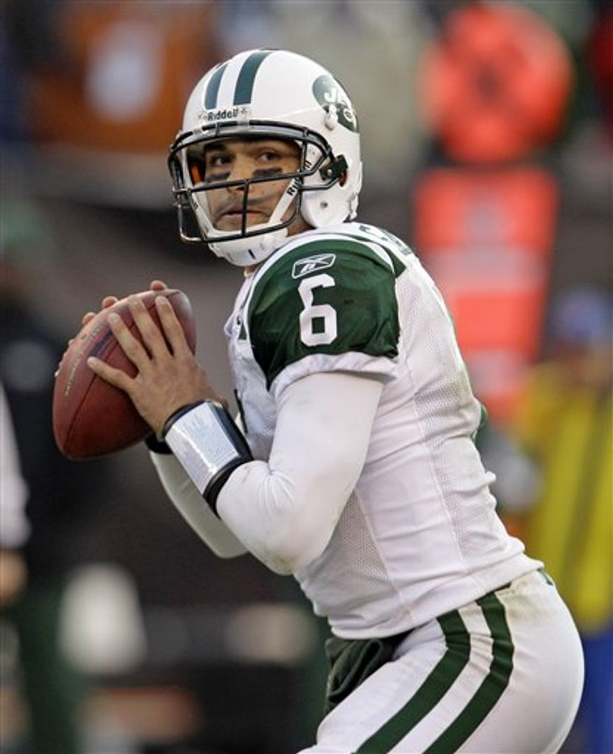 FILE- This Nov. 14, 2010 file photo shows New York Jets quarterback Mark Sanchez looking for a receiver in an NFL football game against the Cleveland Browns in Cleveland. (AP Photo/Tony Dejak,File)