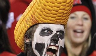 A Nebraksa fan cheers prior the an NCAA college football game against Kansas, in Lincoln, Neb., Saturday, Nov. 13, 2010. (AP Photo/Nati Harnik)