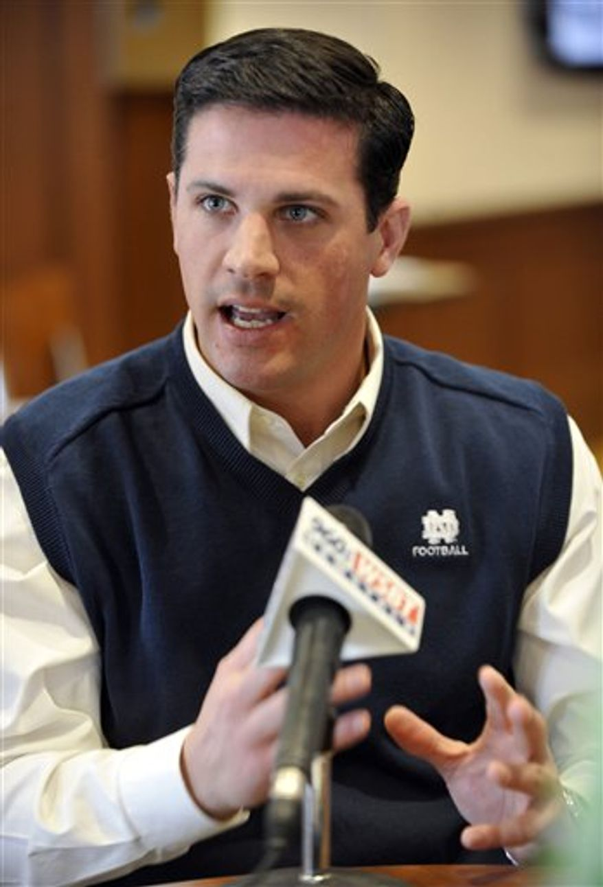 FILE - In this Jan. 15, 2010, file photo, Bob Diaco, new Notre Dame football defensive coordinator and inside linebackers coach, addresses the media during an NCAA college football news conference in South Bend, Ind. The season is salvageable for Notre Dame. First the Irish have to figure out how to stop the triple-option offense of a service academy team. Against Navy a month ago , the Irish couldn't do it. If they want to beat Army on Saturday and secure a bowl bid, Diaco is going to have to make major adjustments. (AP Photo/Joe Raymond, File)