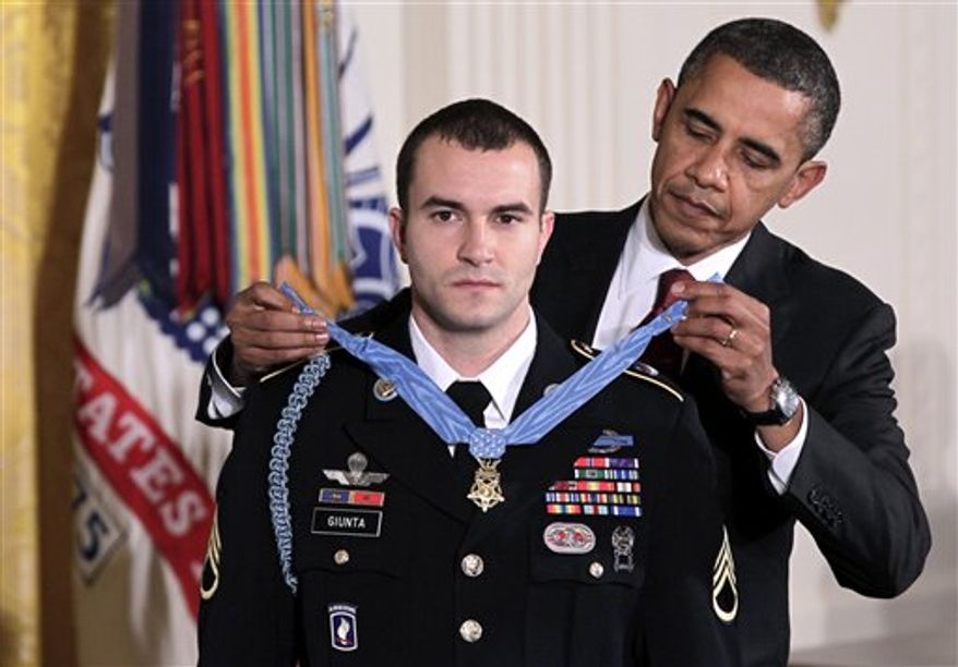President Barack Obama presents the Medal of Honor to Staff Sgt. Salvatore Giunta, who rescued two members of his squad in October 2007 while fighting in the war in Afghanistan, Tuesday, Nov. 16, 2010, at the White House in Washington.  (AP Photo/J. Scott Applewhite)