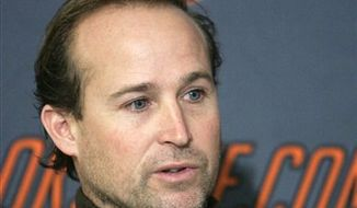FILE - In this Feb. 3, 2010, file photo, Oklahoma State offensive coordinator Dana Holgorsen addresses the media during a news conference in Stillwater, Okla. Holgorsen quickly establishing himself as one of the top offensive minds in college football while guiding the nation's most productive offense at No. 12 Oklahoma State. (AP Photo/Sue Ogrocki, File)