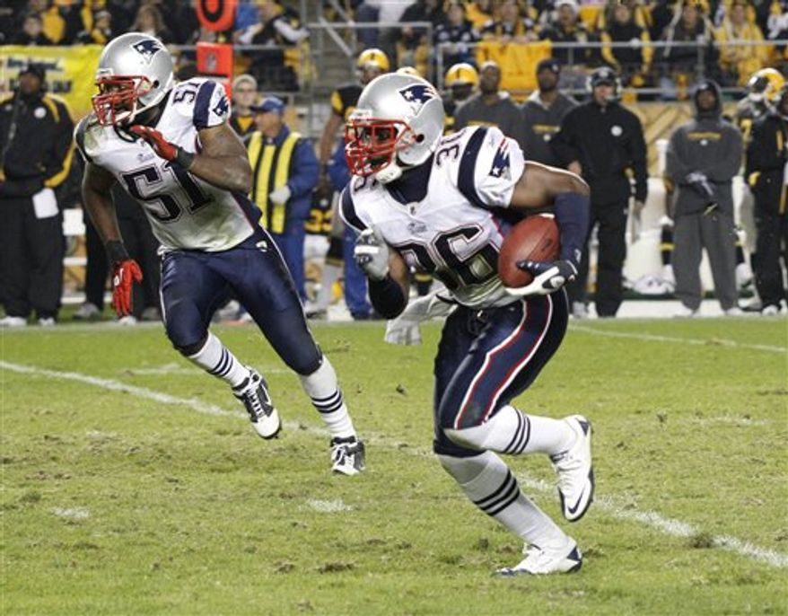New England Patriots quarterback Tom Brady (12) runs off the field after a 39-26 win over the Pittsburgh Steelers in an NFL football game in Pittsburgh, Sunday, Nov. 14, 2010. (AP Photo/Gene J. Puskar)