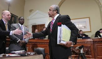 Rep. Charles Rangel, New York Democrat, right, reaches out to shake hands with Blake Chisam, chief counsel for the House Committee on Standards of Official Conduct, on Capitol Hill in Washington, Monday, Nov. 15, 2010. (AP Photo/J. Scott Applewhite)