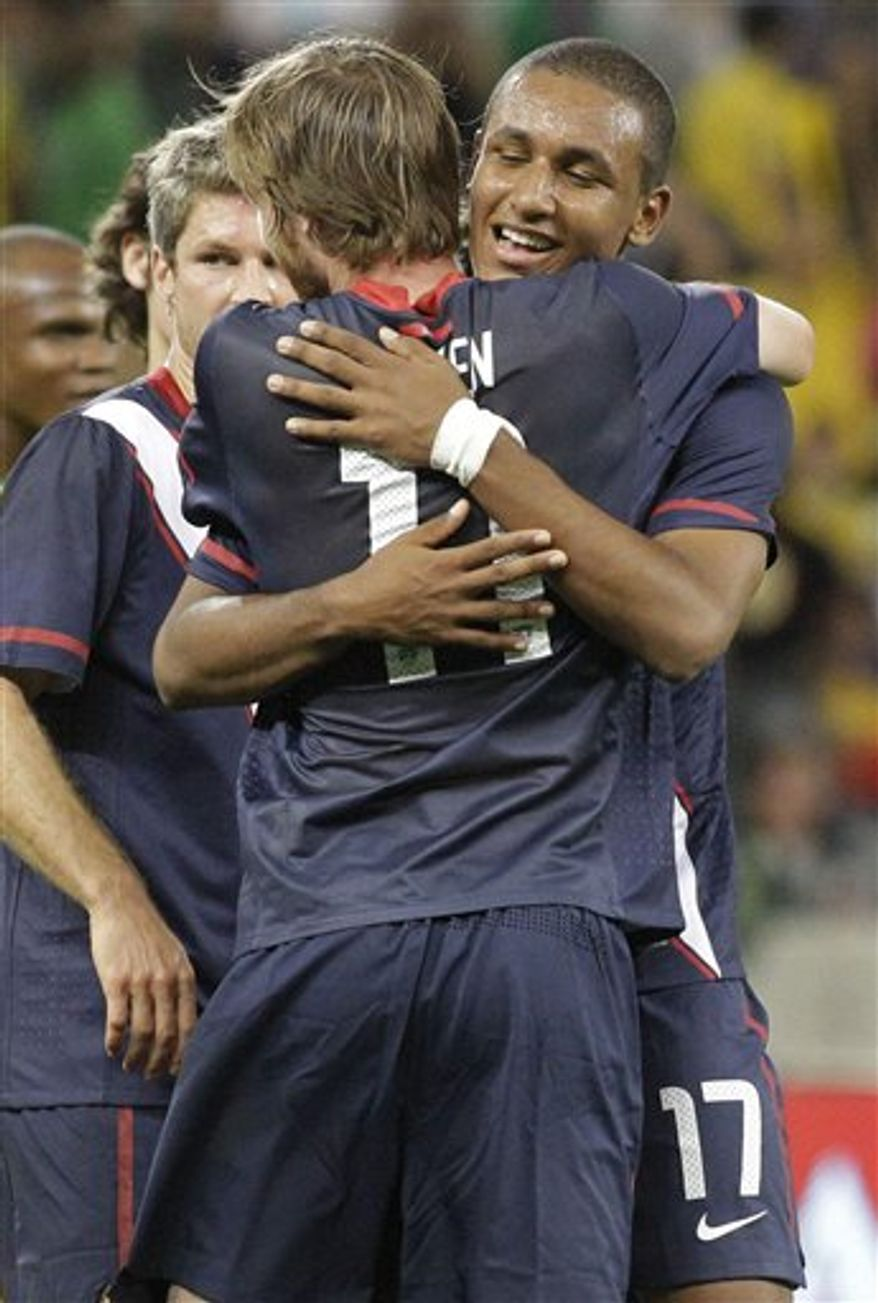 United States players Eddie Gaven (11) and Juan Agudelo (17) celebrate after they beat South Africa 1-0 in an international friendly soccer match in the Nelson Mandela Challenge at Cape Town, South Africa, Wednesday, Nov. 17, 2010. Agudelo score the USA's winner. (AP Photo/Schalk van Zuydam)AP Photo/Schalk van Zuydam)