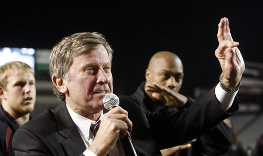 South Carolina football coach Steve Spurrier waves to fans after South Carolina returned from Florida after South Carolina's 36-14 win in an NCAA college football game, early Sunday, Nov. 14, 2010, in Columbia, S.C. No. 17 South Carolina is heading to its first Southeastern Conference championship game after winning the East division. (AP Photo/The State, Kim Kim Foster-Tobin)