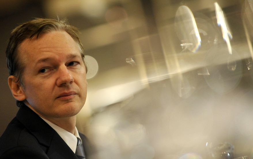 WikiLeaks founder Julian Assange speaks during a press conference in London on Oct. 23, 2010. A Swedish prosecutor has asked for a court order to detain Mr. Assange for questioning on suspicions of rape, sexual molestation and unlawful coercion.(AP Photo/Lennart Preiss/File)