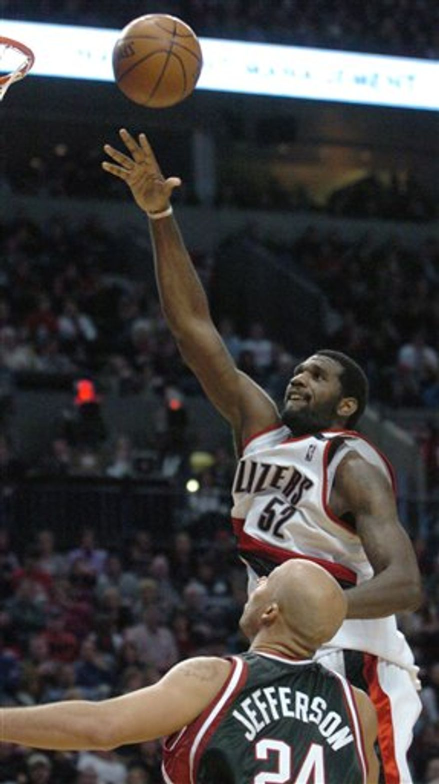 FILE - In this Jan. 19, 2009, file photo, Portland Trail Blazers' Greg Oden (52) shoots over Milwaukee Bucks' Richard Jefferson (24) during the second half of an NBA basketball game in Portland, Ore. Oden will have microfracture surgery on his left knee and will not play in the 2010 season. Oden has not played since December 2009 because he needed surgery to repair a fractured left patella. (AP Photo/Greg Wahl-Stephens, File)