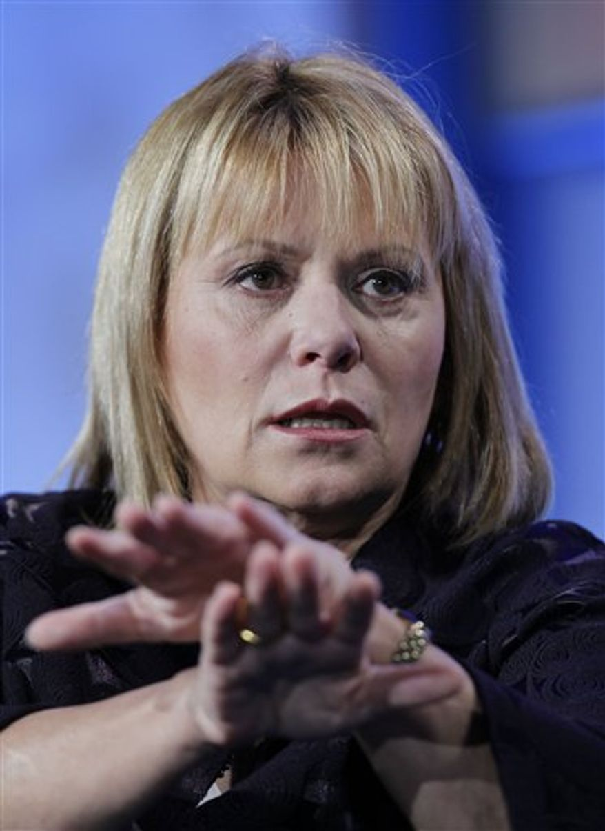 Yahoo CEO Carol Bartz speaks at the Web 2.0 Summit in San Francisco, Tuesday, Nov. 16, 2010. Yahoo Inc. is hopping on the bargain-hunting bandwagon with Groupon, the Internet's hottest discount broker, and more than a dozen other similar services. (AP Photo/Paul Sakuma)