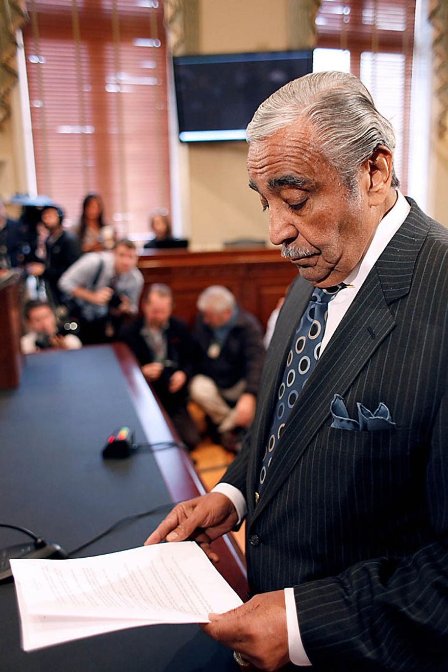 Rep. Charles Rangel, D-N.Y. goes over his notes while appearing before the House Ethics Committee, on Capitol Hill in Washington, Thursday, Nov. 18, 2010. (AP Photo/Harry Hamburg)
