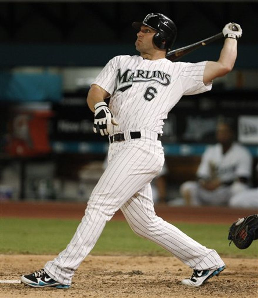 In this Sept. 18, 2010, photo, Florida Marlins' Dan Uggla bats in a baseball game against the Chicago Cubs in Miami. Uggla has been traded from the Marlins to the Atlanta Braves for infielder Omar Infante and left-hander Mike Dunn. (AP Photo/Alan Diaz)