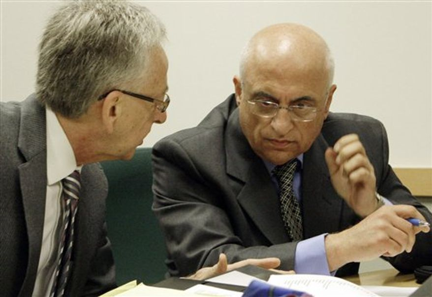 """FILE- In this Monday Oct. 18, 2010 file photo showing fertility specialist Dr. Michael Kamrava, right, and his attorney Henry R. Fenton prepare for a hearing before the California Board of Medical Examiners on possible suspension or revocation of his medical license, in Los Angeles.  He is accused of """"grossly negligent'' treatment of `""""Octomom'' Nadya Suleman and another patient. (AP Photo/Reed Saxon)"""